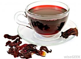 cup-of-hibiscus-tea-surrounded-by-dried-petals